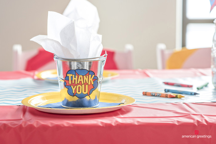 mini metal buckets filled with sparkly white tissue and labeled with free printable Thank You tags