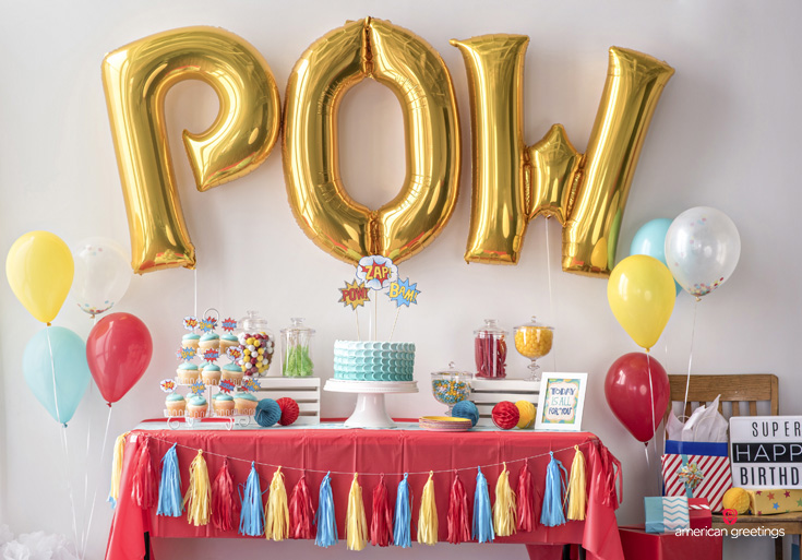 POW balloon, food and drink table decorated with tassel garland
