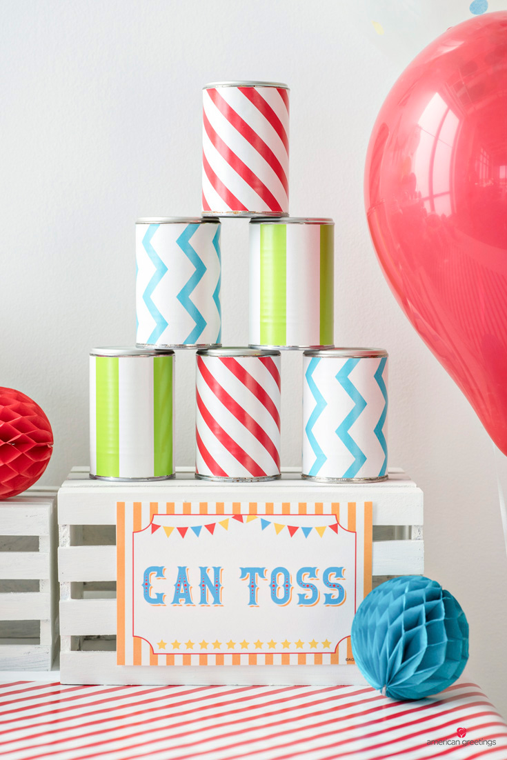 old cans wrapped in patterned reversible wrapping paper
