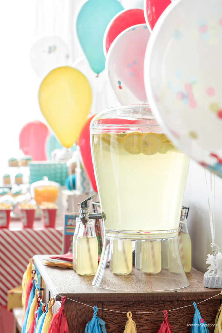 floating lemons in a clear glass beverage dispenser