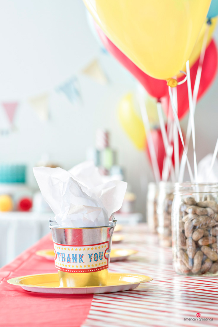 Party favors in metal mini-buckets with thank you labesl filled with tissue paper