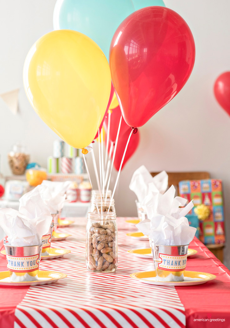 ounce mason jars with a balloon weight in the center of each