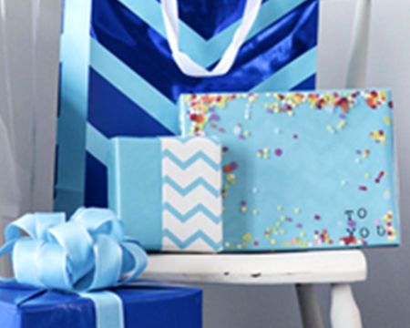 Blue wrapped gift boxes and gift bags