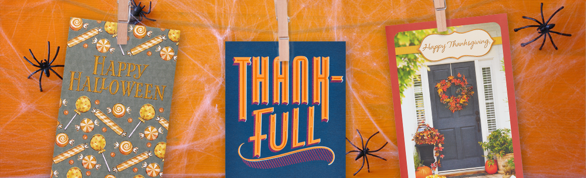 Happy Halloween, Thankful, and Happy Thanksgiving cards on a clothsline with spiders in the background.