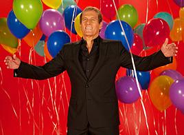 Michael Bolton with balloons - Send Michael Bolton ecard