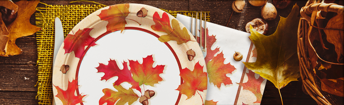 Autumn Days plate displayed on a Thanksgiving table with leaves and acorns