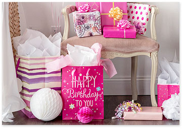 Pretty Pink Birthday Gifts and Bags on a Chair - Shop birthday gift wrap and bags