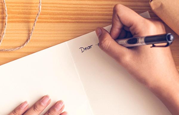 Woman writing a card