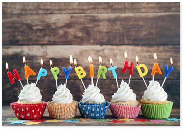 Row of cupcakes with candles that spell happy birthday - View birthday wishes