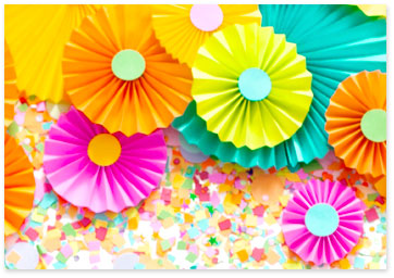 This shows a variety of beautiful colored paper flowers made by hand. View celebration ideas