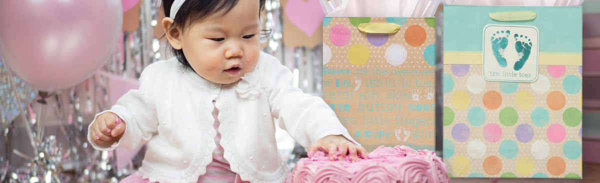 Cute baby surrounded by gift wrap!