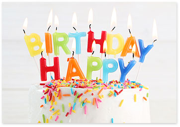 Happy Birthday candles on white cake with sprinkles on top - Find birthday reminders