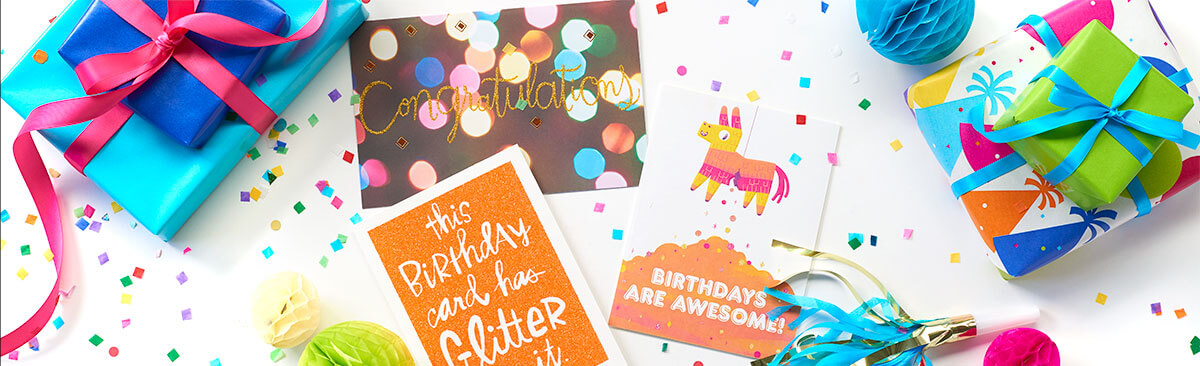 Birthday cards and bright color wrapping paper with colorful ribbon