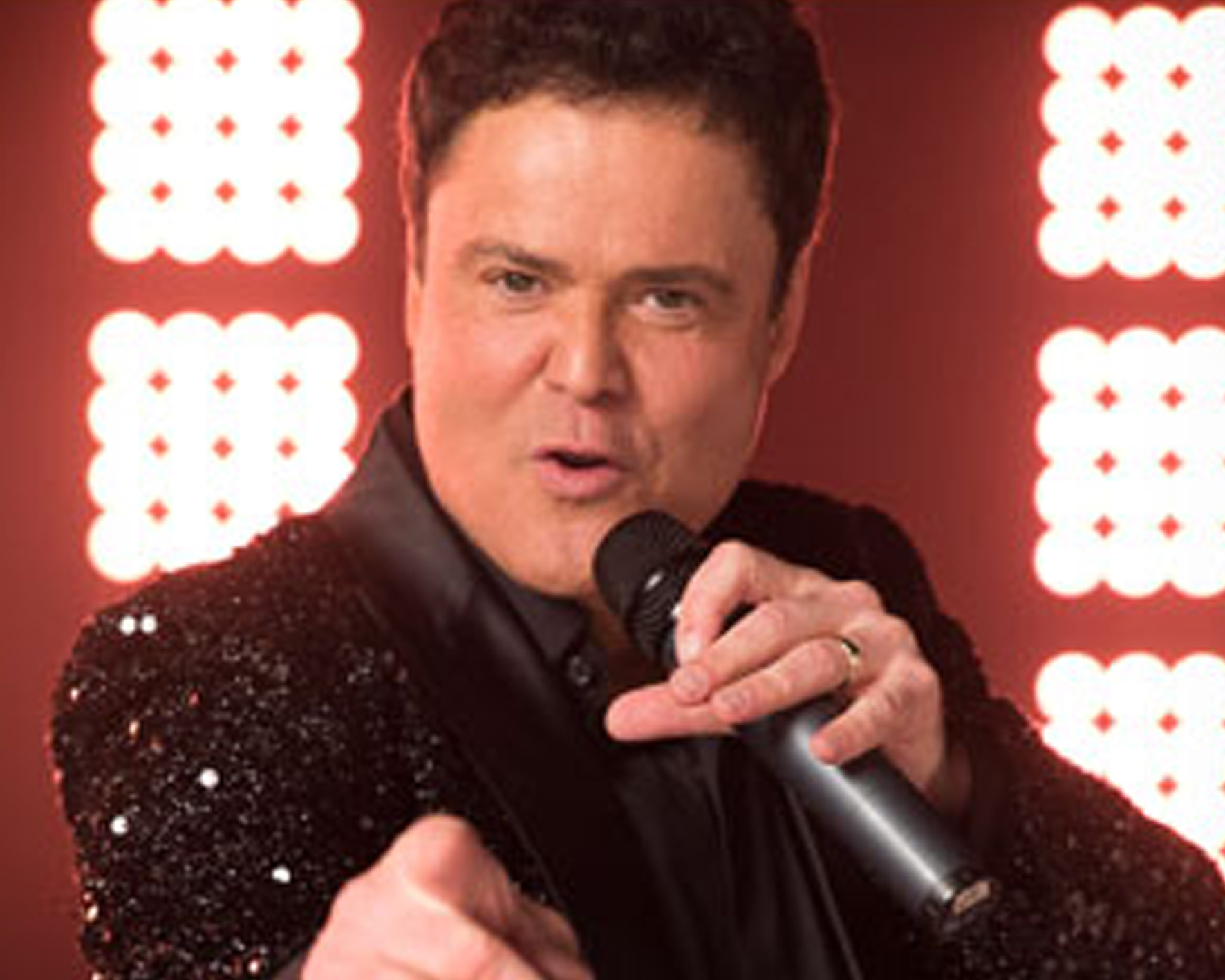 Donny Osmond singing into microphone - View Donny Osmond ecard