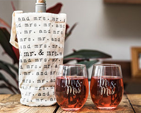 Shop wedding gifts like wine glasses and wine bags for the couple