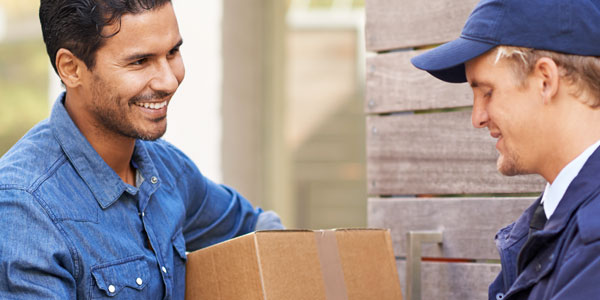 Package being delivered to front door by man