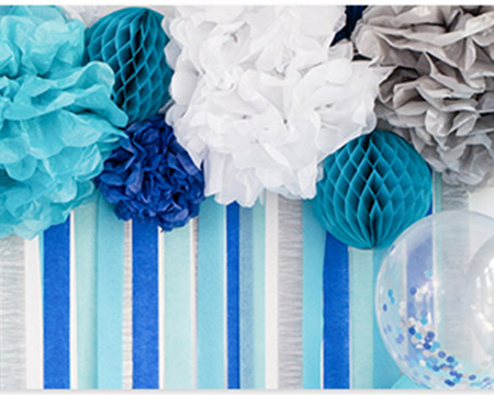 Blue, white and silver honeycombs, balloons and tissue paper pom-poms
