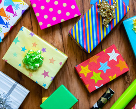Gifts wrapped with various colored wrapping paper