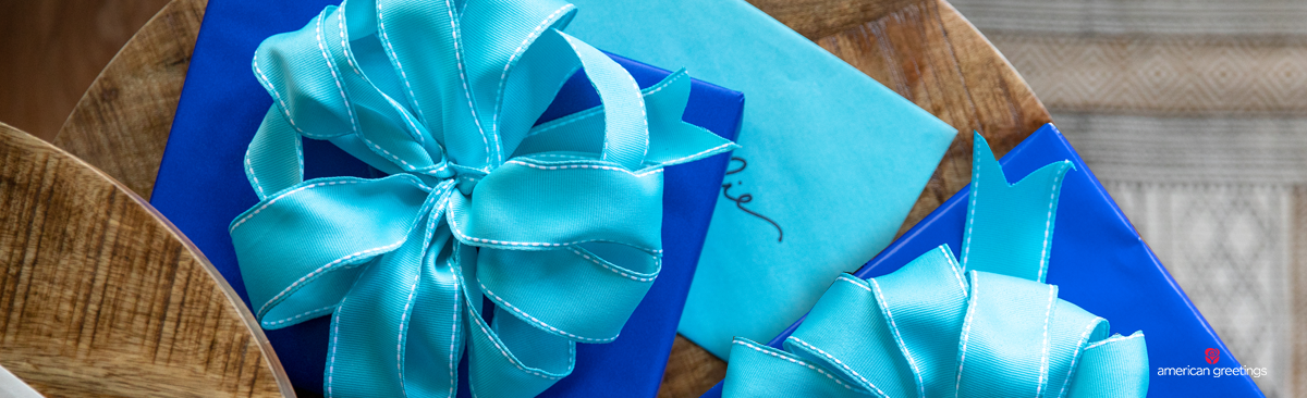 blue gift bow on a blue wrapped gift