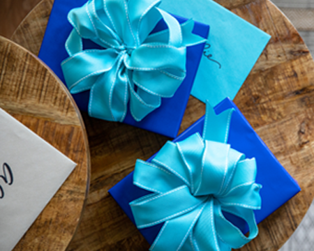two blue wrapped gifts with blue bows