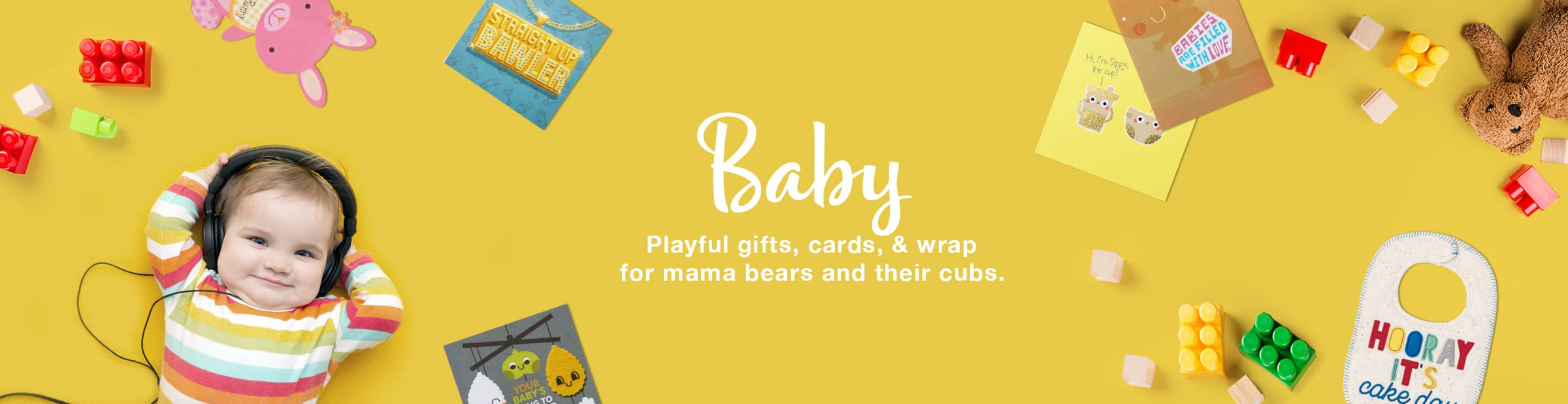 Baby chilling on the floor with his toys, greeting cards and bibs - Shop Baby Ecards, Cards, Gifts and more