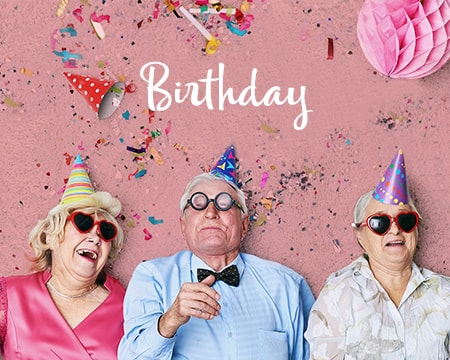 3 Elderly people celebrating a big birthday with confetti and party hats - Shop Birthday