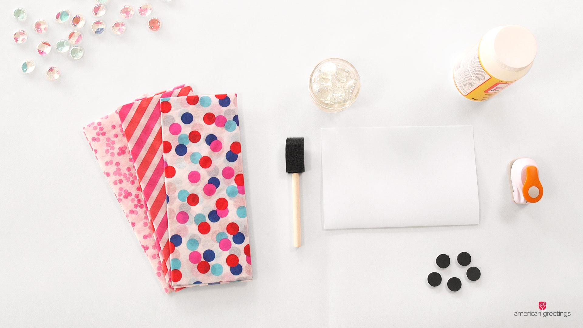 Tissue paper, foam brush, glass gems, paper, glue, magnets