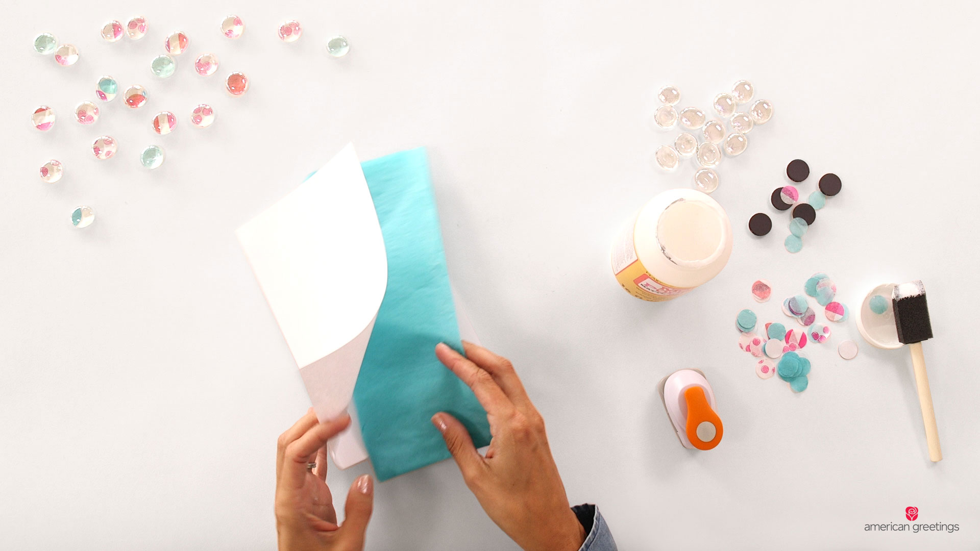 Step 1 - cut out your tissue paper circles, fold a piece of paper in half and slide your tissue paper into the sleeve you've made.