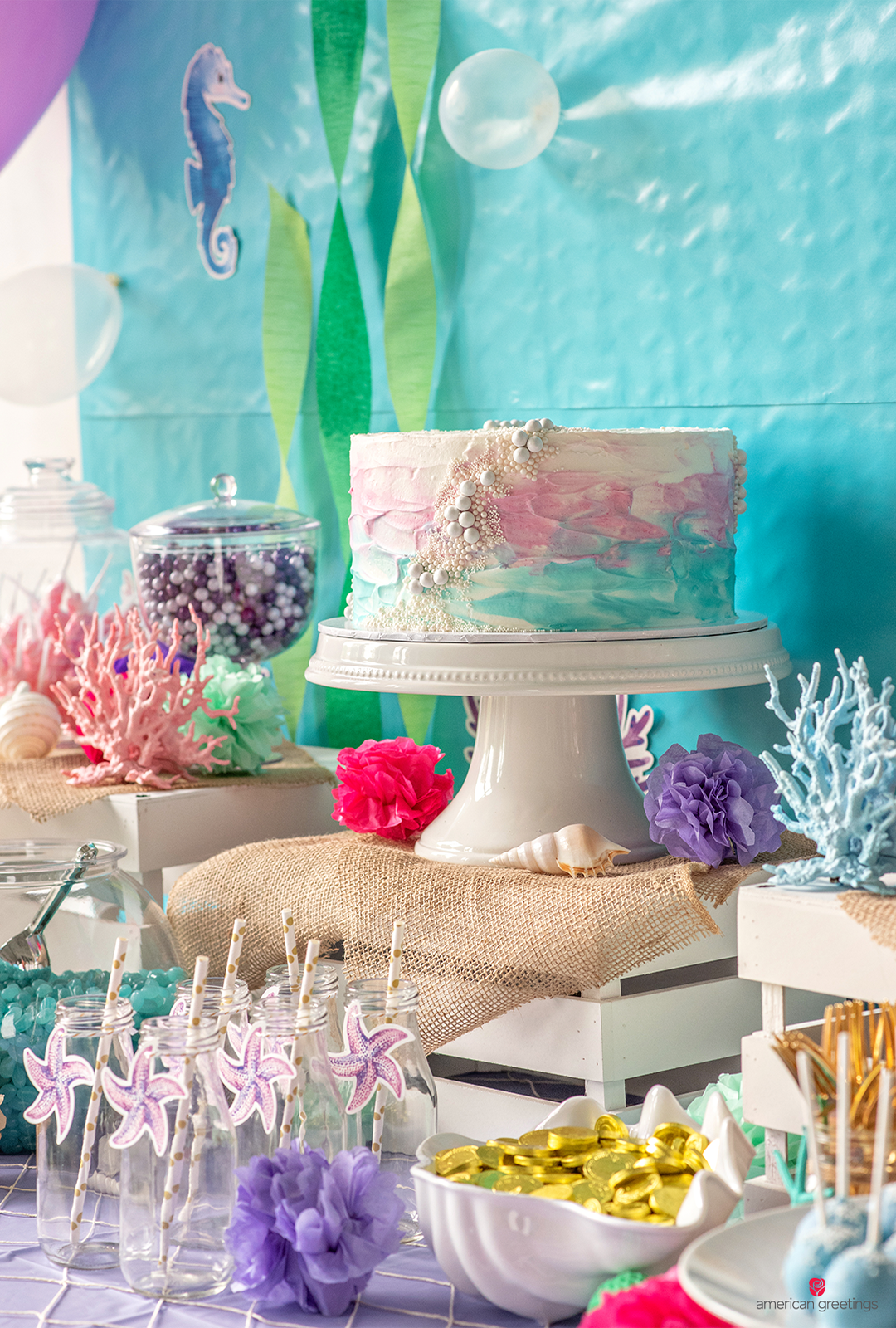 Cake on a stand, accessorized with pearl candies