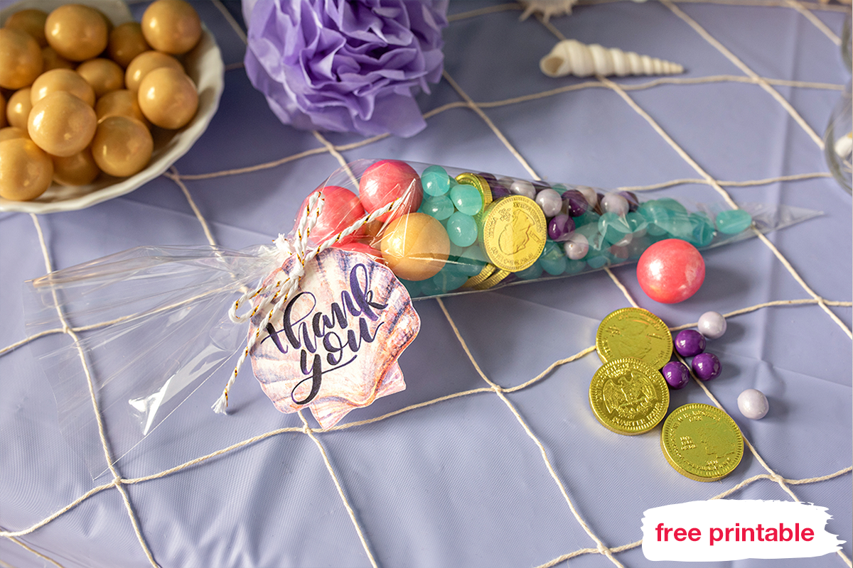 Cellophane bags filled with shades of purple chocolate gems, include blue jelly beans, golden chocolate coins