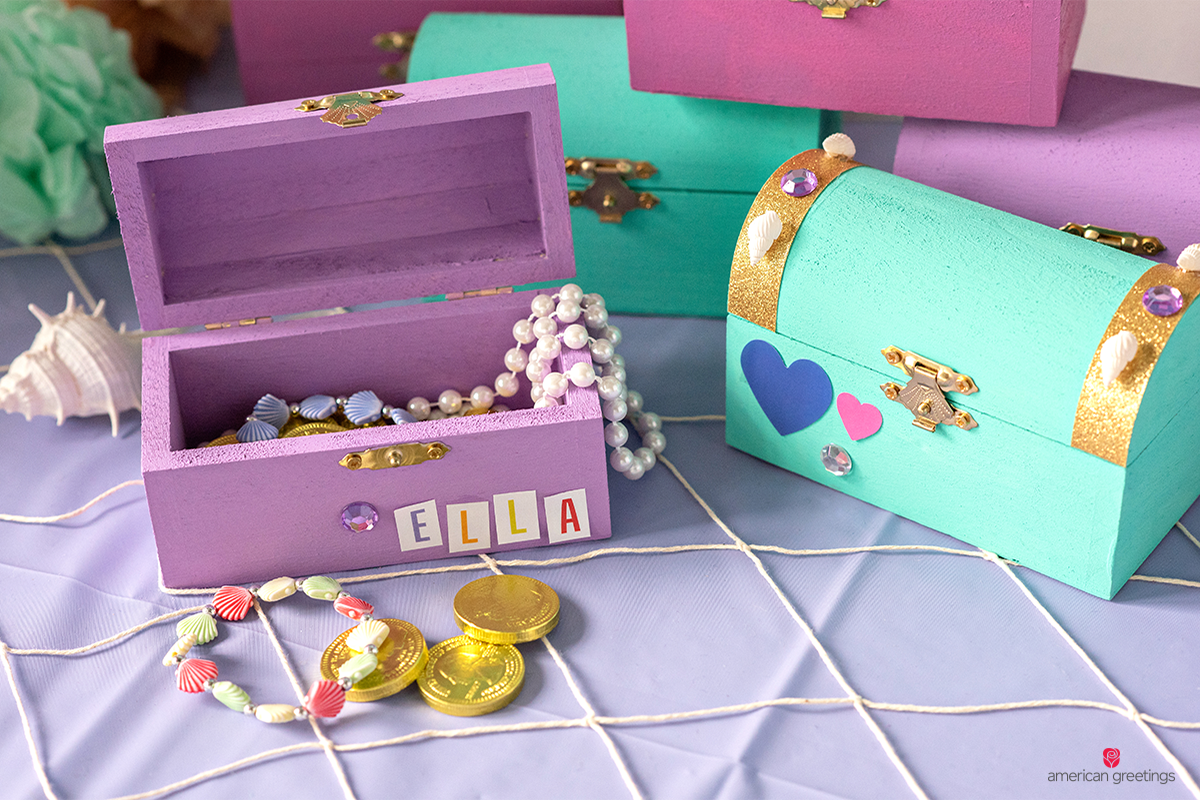 Mini treasure boxes  filled with shell/pearl bracelets, necklaces and chocolate gold coins