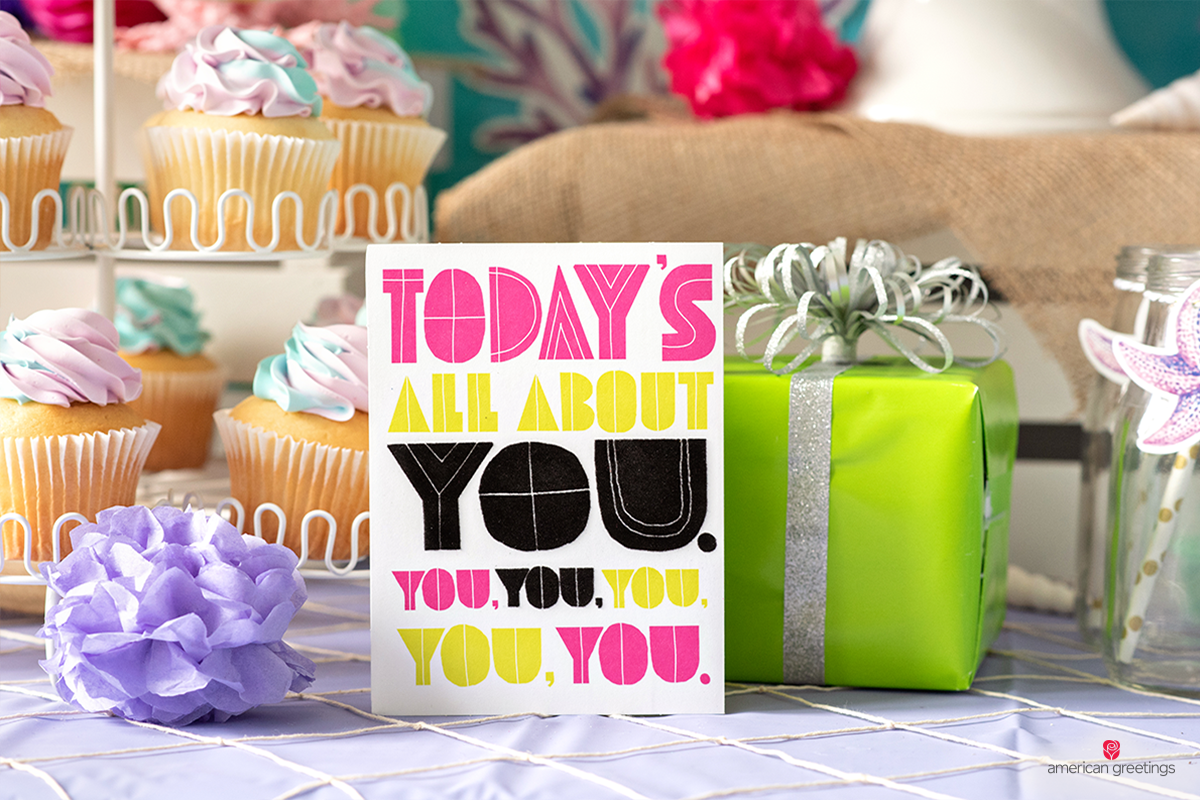 Today's about you card message next to a green wrapped gift