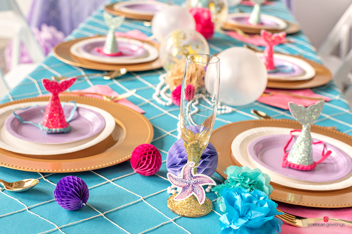 Plates decorated with mini mermaid hats