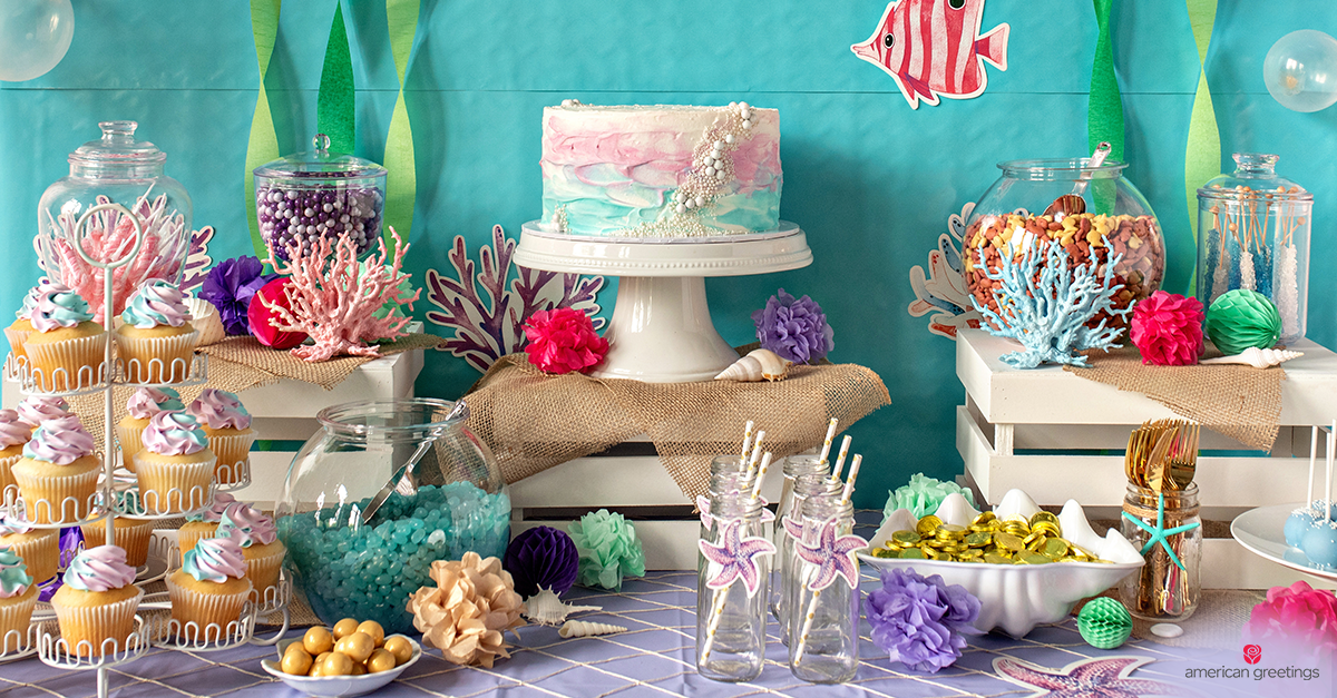 Overall image with the table setup and the candy bar for the mermaid party
