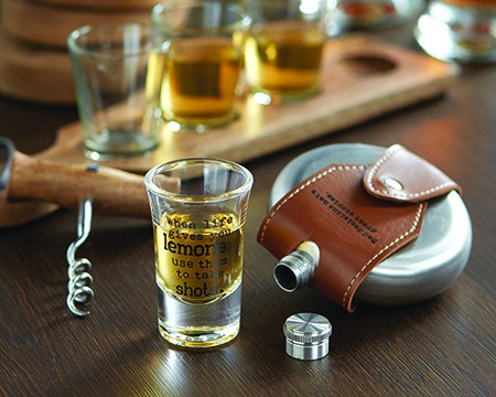 Shot glass and flask on a table - Shop barware