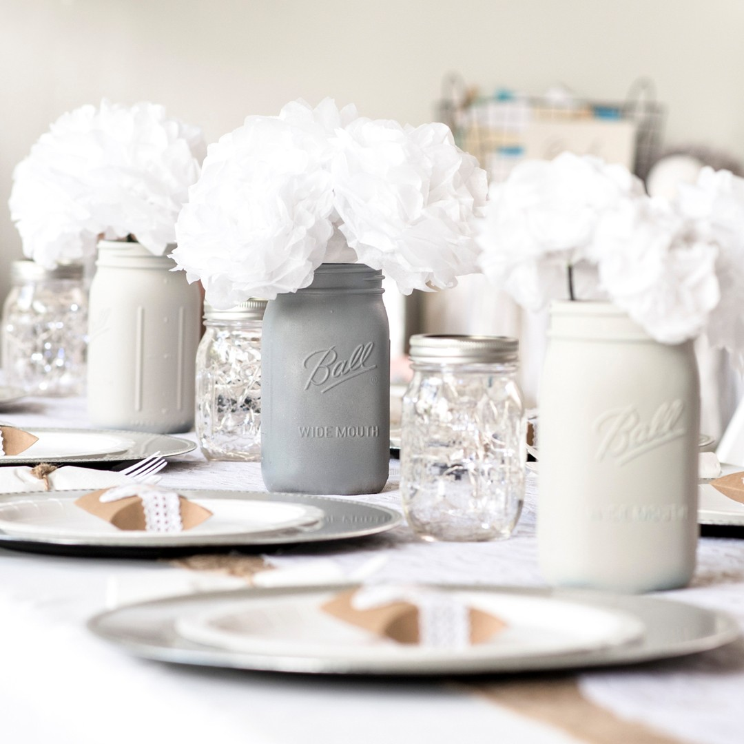 White Tissue Paper Flowers and Painted Mason Jars. View Celebration Ideas.