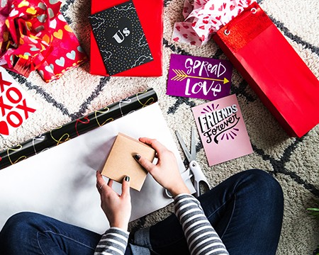 Valentine's Day Gift Guides - Girl Wrapping A Gift