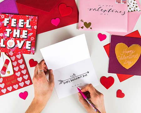 Writing a Valentines Day Message in a Greeting Card