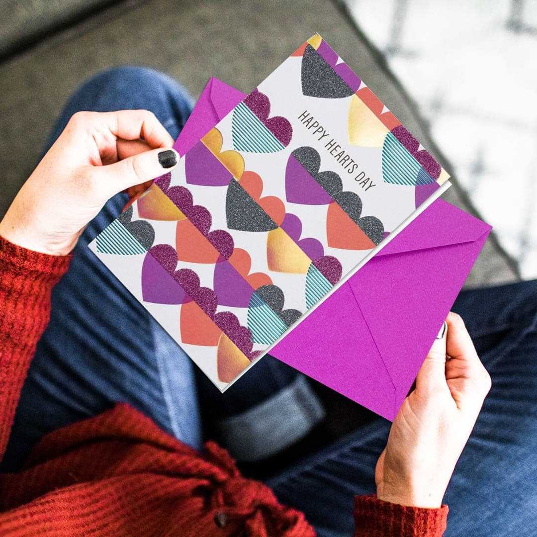 Female Holding a Happy Hearts Day Greeting Card