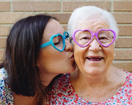 A Grandma and Granddaughter Kissing Her Cheek