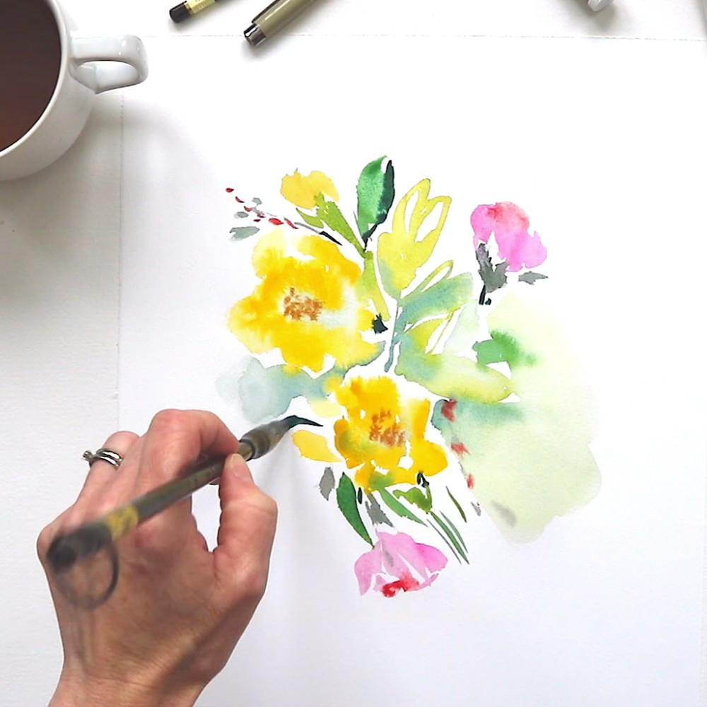 Woman Painting Flowers inside the Kathy Davis Art Studio