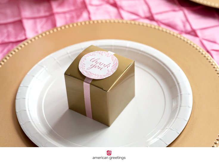 pink and gold birthday party gold box on plate