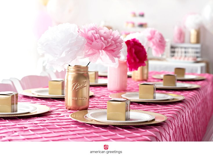 pink and gold birthday party table setting gold jar