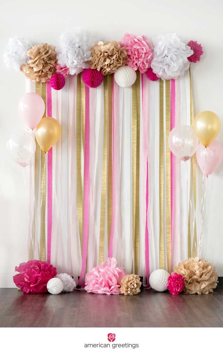 pink and gold tissue paper pom-pom backdrop