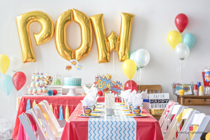 POW! ballon, superhero themed dining table complete with a centerpiece, party favors and balloons