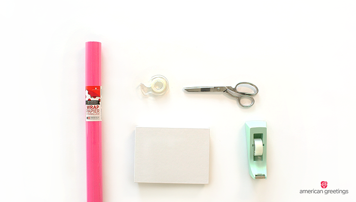 Supplies you'll need: a gift box, tape, scissors, double sided tape, reversible wrapping paper
