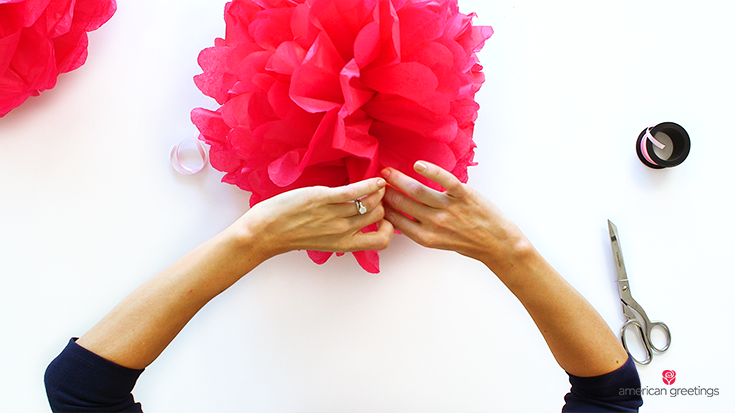 Inexpensive, easy DIY tissue paper pom poms for parties and dorm decoration