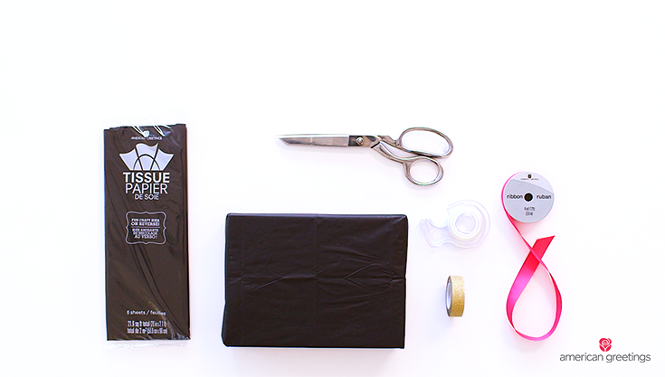 Supplies you'll need: a gift box, gold washi tape, double sided tape, hot pink grosgrain ribbon, scissors, black tissue paper