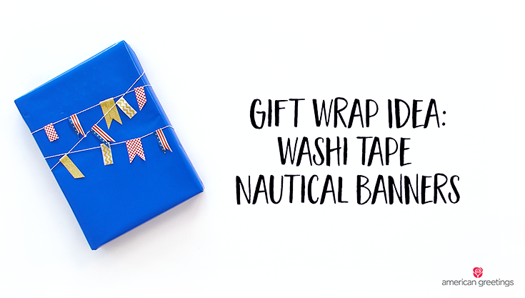 Washi tape nautical banners on a blue gift wrapped box with