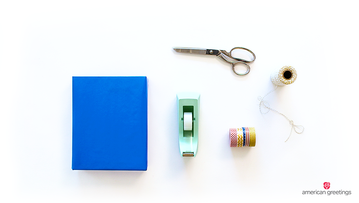 Supplies you'll need: wrapped gift, tape, coordinated washi tape, baker's twine, scissors